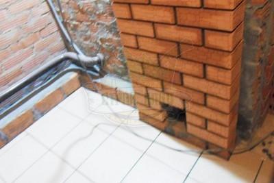 Вентиляционное отверстие в кирпичной стенке